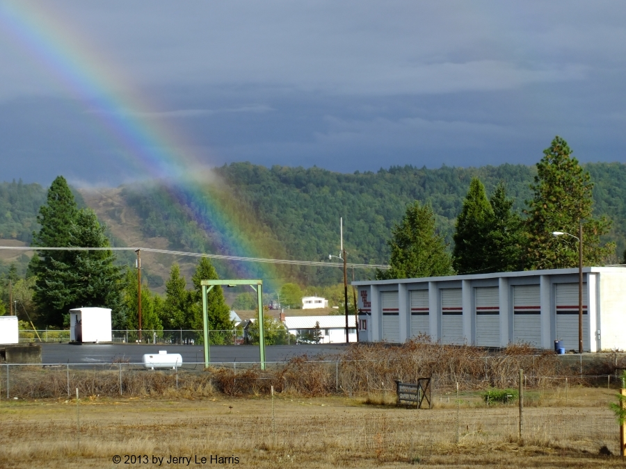 The Lookingglass Rural Fire District building with a rainbow in the background.